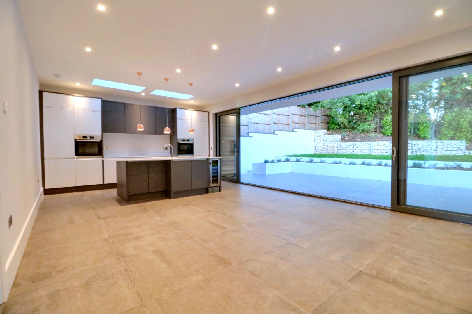 Modern kitchen-living area in London new build transformed with Home Automation by Bryanston Smarthome